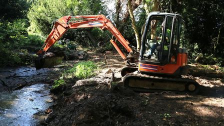 A digger works to excavate an early Victorian bathing pool at Belton Rectoy. Photo: Bill Richmond