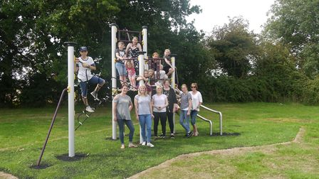 New play equipment at Tacolneston Park. From left to right Jill Smith, Charlotte Hardie, Bonnie Ludk