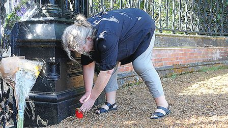 Claudia Thoma from Germany lights a candle in memory of Princess Diana. Picture: Chris Bishop