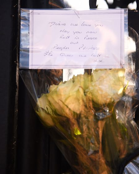 Floral tributes have been left on the Norwich Gates at Sandringham, in memory of Princess Diana. Pic