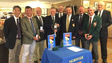 Barnard Trophy winners King's Lynn with county president Graham Turner (fourth right). Picture: Mike