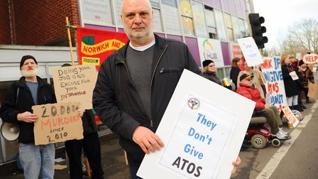 Mark Harrison, CEO Equal Lives, with other protesters outside the Atos assessment centre at St Mary'
