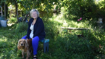 Gill Phillips in her overgrown garden with her dog Loki, before the Thetford police cadets come in t