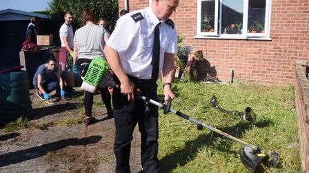 Chief Inspector Paul Wheatley joins the police cadets and volunteers who are clearing Gill Phillips'