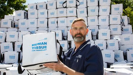 NHSBT nurse Marc Coe with empty transplant boxes showing missed opportunities. Photo: Richard Crease