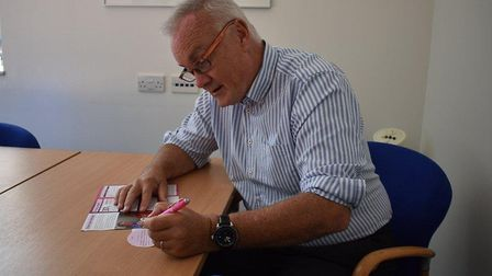 Mark Davies signs up to the Organ Donation Register. Photo: NNUH