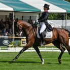 Piggy French riding Vanir Kamira during the dressage phase of the Land Rover Burghley Horse Trials.