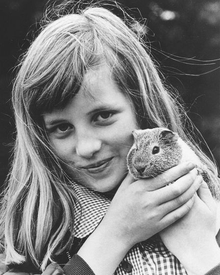 Princess Diana with her guinea pig Peanut in 1972. Picture: Archant Library