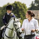 Darcy Fowler and her horse Nutkin take first place in the World Horse Welfare Parade. Picture: Sport
