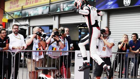 George Russell jumps for joy after securing victory in the opening GP3 race at Spa-Francorchamps. Pi