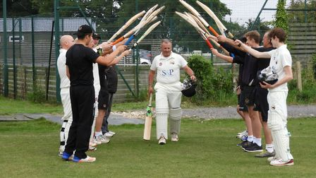 Long-serving Steve Goldsmith receives a guard of honour from his Vauxhall Mallards team-mates after