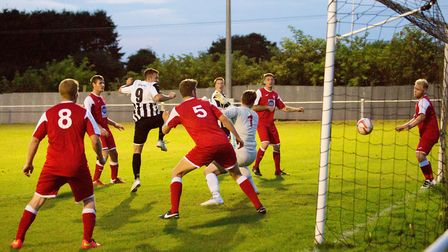 Swaffham Town's Blake Stangroome rises to convert from Nick Castellan's corner with the keeper beate