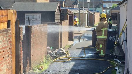 Firefighters tackle the shed blaze in Lowestoft. Picture: Mick Howes