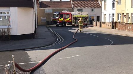 Firefighters at the scene of the shed blaze in Lowestoft. Picture: Tom Chapman