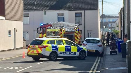 Police and firefighters at the scene of the shed blaze in Lowestoft. Picture: Mick Howes