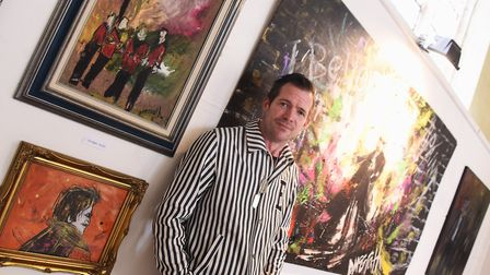 Daniel McGrath with his work at an earlier exhibition. Picture: DENISE BRADLEY