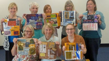 A group photo in a workshop for artistic textile panels. Photo: Great Yarmouth Presentation Trust