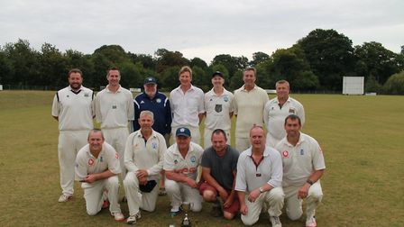 Bircham Over-40s line up for a team picture after winning the county title. Picture: Norfolk CB