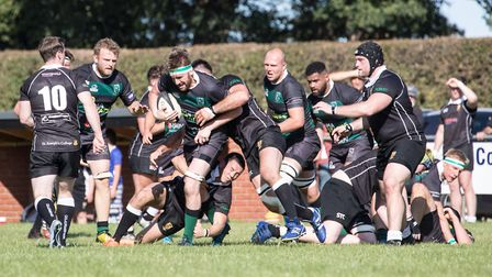 North Walsham come up against a determined defence on Saturday. Picture: Hywel Jones
