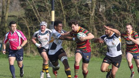Nick Austin hands off an Ipswich opponent during Norwich's narrow 19-17 win in Suffolk on the last d