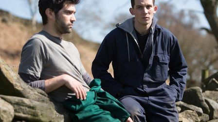 Josh O'Connor as Johnny and Alec Secareanu Romanian worker Gheorghe in God's Own Country. Photo: Pic