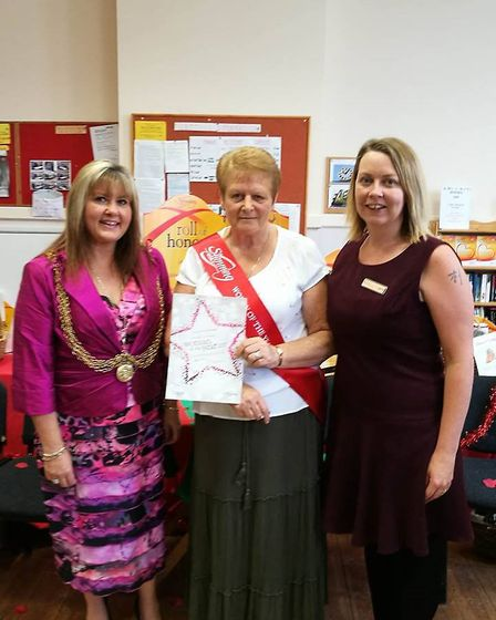 Mandy being presented as winner with Mayor Kerry Robinson-Payne and group leader, Ali Burrell. Photo