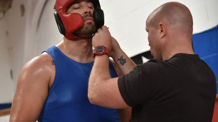 Jon Thaxton adjustsSam Sexton's headguard as he continues his preparations for his British heavywe