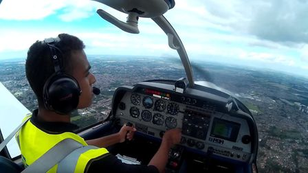 Ben Rourke behind the controls of a plane. Picture: Ben Rourke