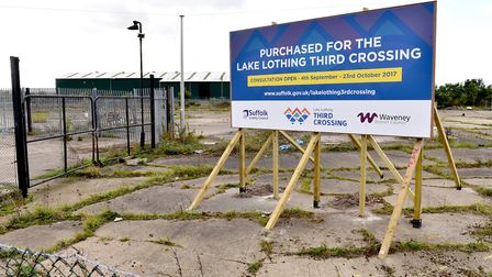 A new sign highlighting that the land close to lake Lothing has been acquired for a major third cros