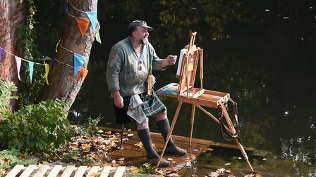 John Behm taking part in Paint Out Norwich by Bishop Bridge, as the tidal River Wensum rises and he