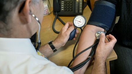 File photo of a GP checking a patient's blood pressure. Photo: Anthony Devlin/PA Wire