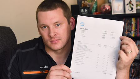 Luke James of L&M Electrical, with his invoice for work he has done on 60 St Faith's Lane which has
