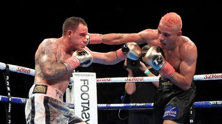 Craig Poxton trades punches with Leon Woodstock. Picture: PA