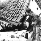 October 1987 storms. Pictured: Kevin Last and his dog, Lady, survey the wrecked garage with his fath
