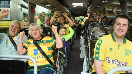 Norwich City football fans on one of the coaches bound for the Emirates Stadium and the Arsenal matc