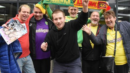 Norwich City football fans arriving for the coaches bound for the Emirates Stadium and the Arsenal m