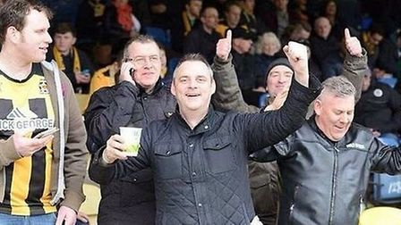 Simon Dobbin, before he was injured, at a Cambridge United match. Picture: PROVIDED BY THE FAMILY