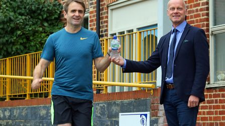 Norfolk and Norwich Association for the Blind (NNAB) head of fundraising Jeremy Goss (right) cheers