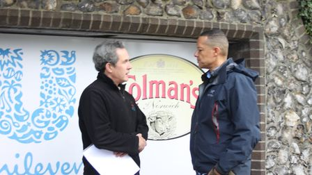 Norwich South MP Clive Lewis, right, speaks to Unite regional officer Miles Hubbard at the Unilever
