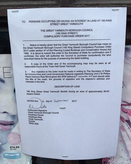 A compulsory purchase order notice is pinned to 160 King Street, a former restaurant that has fallen