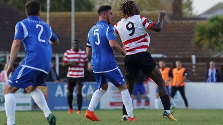 Travis Cole and Noel Mbo battle for possession. Picture: Shirley D Whitlow