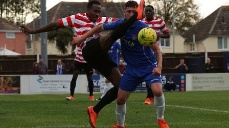 Travis Cole receives a blow to the face at Lowestoft were handed a penalty, which Jake Reed converte