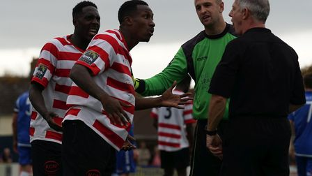 Kingstonian players weren't happy with the referee's decision to award a penalty to Lowestoft. Pictu
