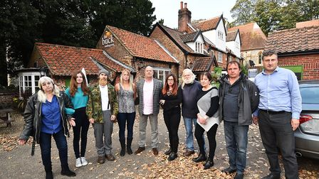 The Buck pub at Thorpe St andrew is due to close. Landlord Russell Evans, centre, pictured with staf