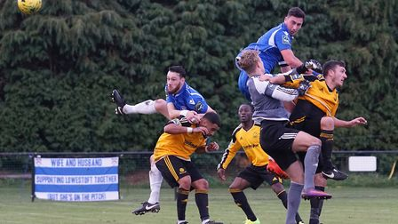 Rory McAuley and Travis Cole challenge for possession during Lowestoft's defeat to Merstham. Picture