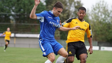 Lowestoft's Callum White and Merstham's Reece Hall challenge for possession. Picture: Shirley D Whit