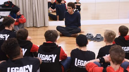 One of Rambert's ghost dancers, Liam Francis, chats to members of the Norwich dance company Legacy.