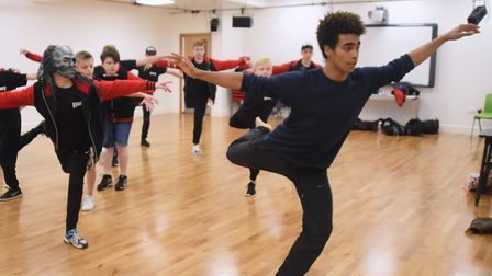 One of Rambert's ghost dancers, Liam Francis, teaches one of the ghost dances to members of the Norw