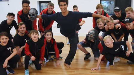 One of Rambert's ghost dancers, Liam Francis, with members of the Norwich dance company Legacy. Pict
