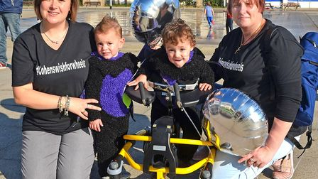 Cohen Messenger with his twin brother Ethan and parents Aimee and Kirstie Messenger. Photo: Mick How
